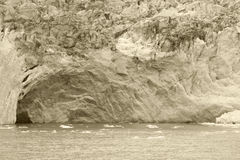 Patagonian landscape with lake, glacier and a cave. Sepia tone. Stock Image