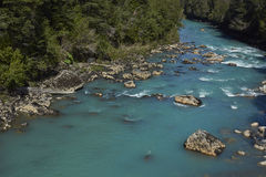 Patagonian River. Clear blue waters of the Rio Frio on the Carretera Austral road in the Aysen Region of southern Chile royalty free stock photos