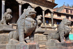 Stone Lion at Patan Durbar Square. Patan Durbar Square is one of three Durbar Squares in the Kathmandu Valley in Nepal, all of which are UNESCO World Heritage Stock Photography