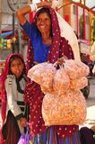 Patan: Indian woman with her daughter and herbal tea bags in her royalty free stock images