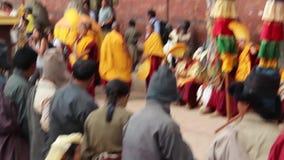 Patan, Nepal - circa 2013: Buddhist monks and Nepali people prepare for ceremony. Patan, Nepal - circa 2013: Buddhist monks and Nepali people chat and play while stock footage