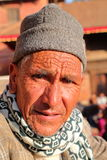 PATAN, NEPAL - DECEMBER 21, 2014: Portrait of an old Nepalese man at Durbar Square Royalty Free Stock Images