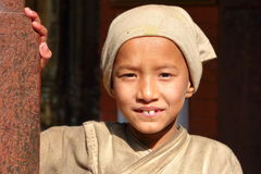 PATAN, NEPAL - DECEMBER 22, 2014: Portrait of a young monk at the Golden Temple Royalty Free Stock Photography