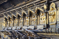 Patan, Nepal, October, 09, 2013, Nepali  Scene: ancient  monastery Kwa Bahal, golden high relief sculpture, Royalty Free Stock Photo