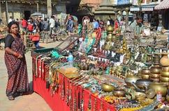 Patan, Nepal, October, 26, 2012, Nepali  Scene: woman saling souvenires on Durbar square in Patan Royalty Free Stock Photo