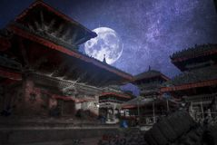 Patan. Ancient city in Kathmandu Valley. Nepal.At night the moon and stars shine Stock Photos