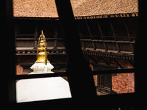 Patan Stupa. Looking out at the stupa in Mani Keshar Chowk one of the many beautiful courtyards in Patan`s Durbar Square, Nepal Stock Image