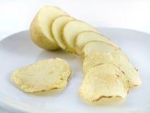 Patata affettata in patatine fritte dei chip Fotografia Stock