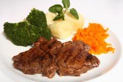 Patata asada a la parilla del bróculi de las zanahorias del filete del ribeye Fotografía de archivo libre de regalías