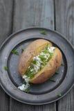 Patata cocida al horno Imágenes de archivo libres de regalías