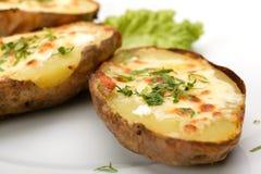 Patata cocida al horno con queso Fotografía de archivo libre de regalías