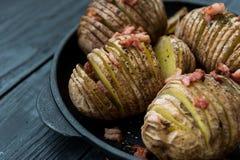 Patata cocida con tocino y especias Foto de archivo libre de regalías
