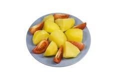Patata con i pomodori su una zolla Fotografie Stock Libere da Diritti
