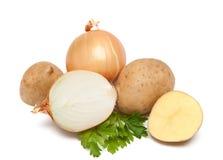Patata con la cebolla y el perejil Fotos de archivo