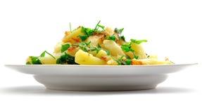 Patata con verdes imagen de archivo libre de regalías