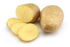 Patata cruda e patata affettata Fotografia Stock