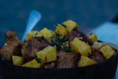 Patata de Ojahuri con cerdo Imagen de archivo