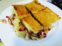 Patata del forno farcita con rosso del melograno Immagine Stock Libera da Diritti