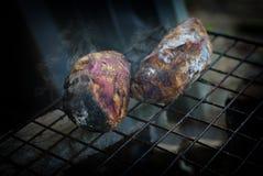 Patata grigliata su carbone Fotografie Stock
