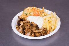 Patata y carne en un plato Foto de archivo libre de regalías
