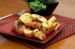 Patatas asadas horno Imagen de archivo