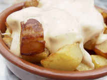 Patatas Bravas. Is a popular Spanish tapa made of fried potatoes served with a spicy sauce Royalty Free Stock Photos