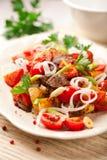 patatas Cacerola-cocinadas con la carne y las cebollas (el Tyrol) imagenes de archivo
