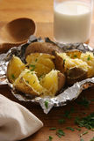 Patatas cocidas al horno. Imágenes de archivo libres de regalías