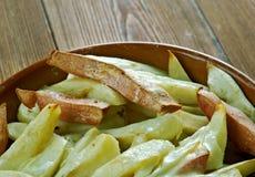 Patatas cocidas finlandesas con el jamón Fotos de archivo
