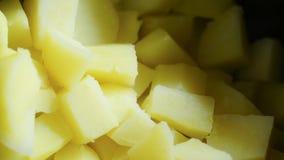 Patatas cocinadas y cubicadas Imagenes de archivo