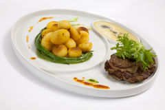 Patatas con carne de vaca Imagen de archivo libre de regalías