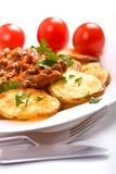 Patatas con la salsa de tomate de la carne fotografía de archivo libre de regalías
