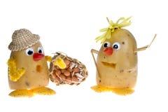 Patatas con los sombreros Imagenes de archivo