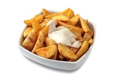 Patatas de la cuña imagenes de archivo