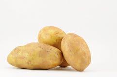 Patatas en blanco Fotografía de archivo libre de regalías