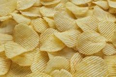 Patatas fritas acanaladas curruscantes fotografía de archivo libre de regalías