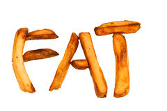 Patatas fritas cocidas horno aisladas deletreando el FAT Imágenes de archivo libres de regalías