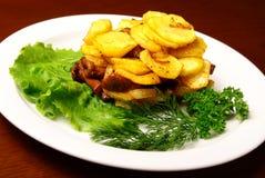 Patatas fritas con las setas Imagenes de archivo