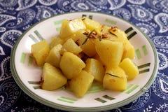 Patatas fritas con romero imagen de archivo