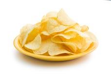 Patatas fritas curruscantes en la placa Foto de archivo