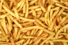 Patatas fritas de oro de los alimentos de preparación rápida Imagen de archivo libre de regalías