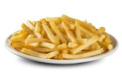 Patatas fritas en plato Fotos de archivo libres de regalías