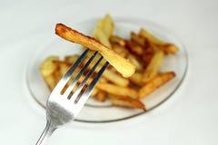 Patatas fritas en una fork Imagenes de archivo