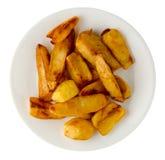 Patatas fritas en una placa fotografía de archivo
