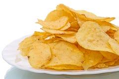 Patatas fritas en una placa blanca imágenes de archivo libres de regalías