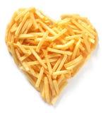 Patatas fritas rectas del corte en la forma del corazón Imágenes de archivo libres de regalías