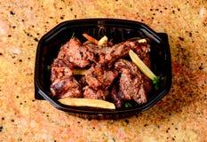 Patatas fritas y carne asada Imagen de archivo