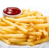 Patatas fritas y salsa de tomate Fotografía de archivo libre de regalías