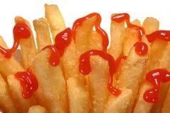 Patatas fritas y salsa de tomate Foto de archivo