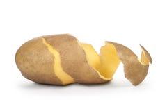 Patatas peladas con la piel Imagen de archivo libre de regalías